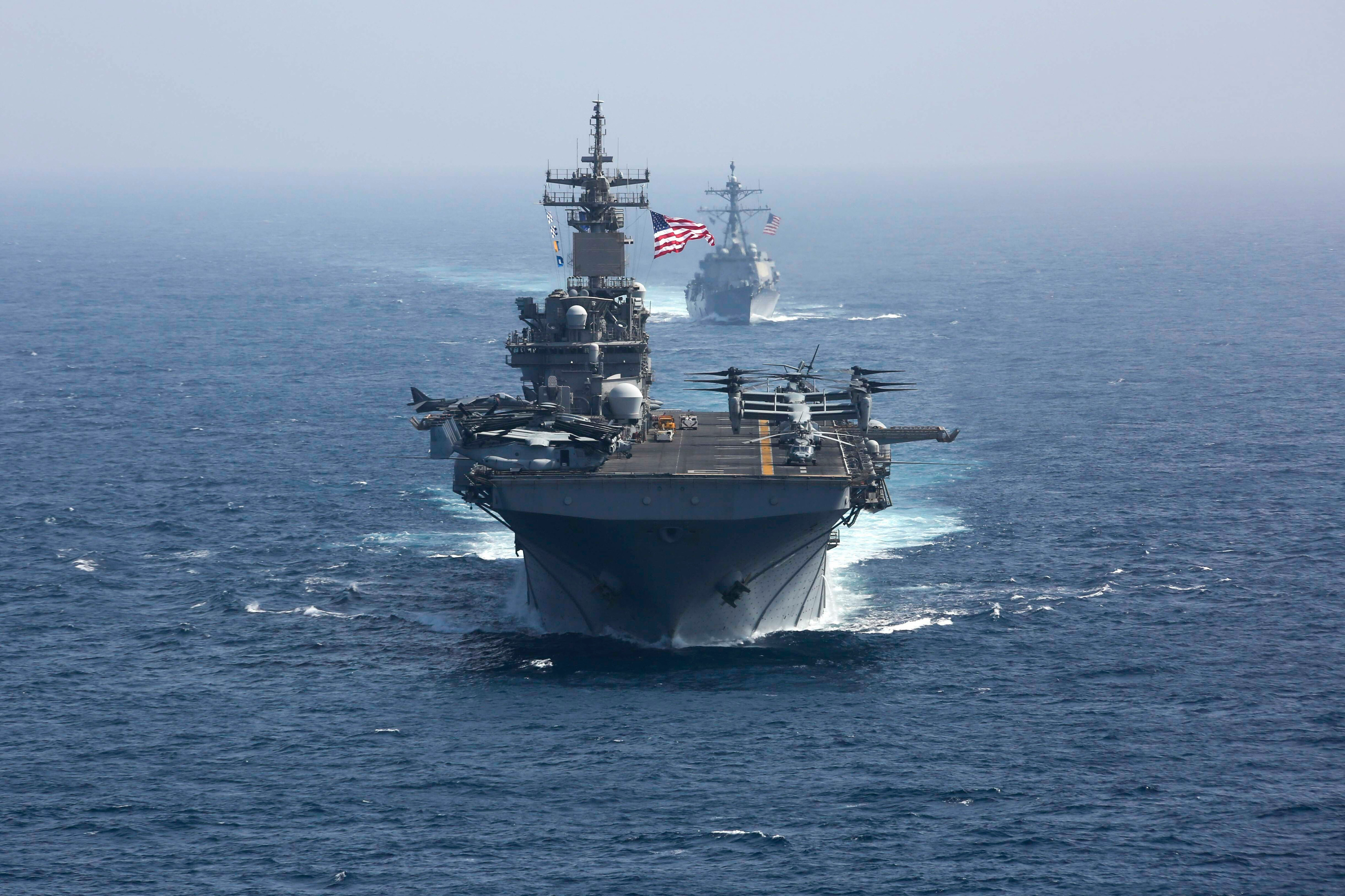 The amphibious assault ship USS Kearsarge (front) and the Arleigh Burke-class guided-missile destroyer USS Bainbridge