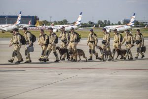 Czech Urban Search and Rescue (USAR) personnel about to board a plane at the Vaclav Havel Airport in Prague