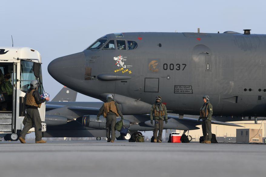 "Pilots from the 69th Bomb Squadron board B-52H Stratofortress bomber ""Wham Bam II"" in preparation for a flight over the Mideast on March 6, 2021, at Minot Air Force Base, North Dakota. A pair of B-52 bombers flew over the Mideast on Sunday, March 7, 2021, the latest such mission in the region aimed at warning Iran amid tensions between Washington and Tehran. (U.S. Air Force/Senior Airman Josh W. Strickland via AP)"